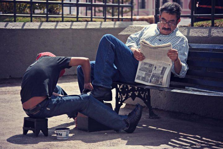 Candid photography - Shoe polisher in San Cristobal De Las Casas, Mexico