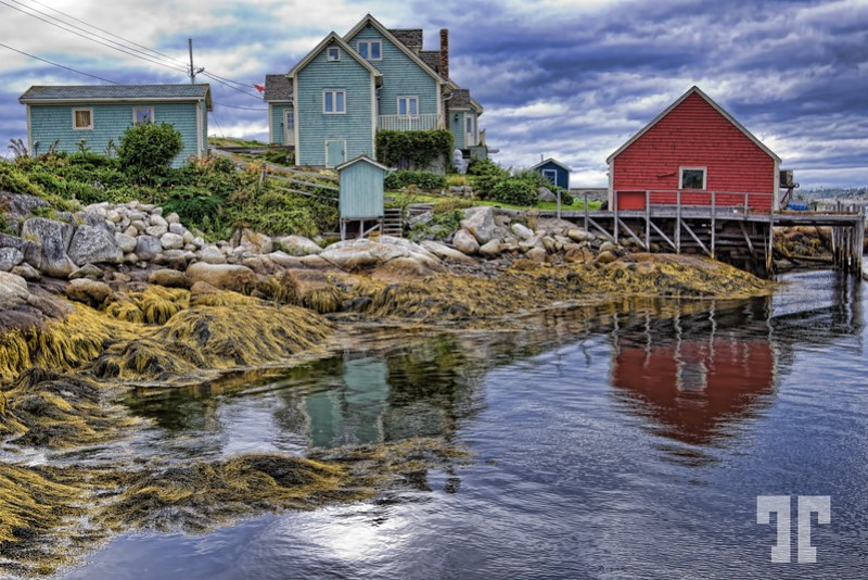 Low Tide at Peggy's Cove: Reflections of colorful fisherman's houses and shacks at Peggy's Cove