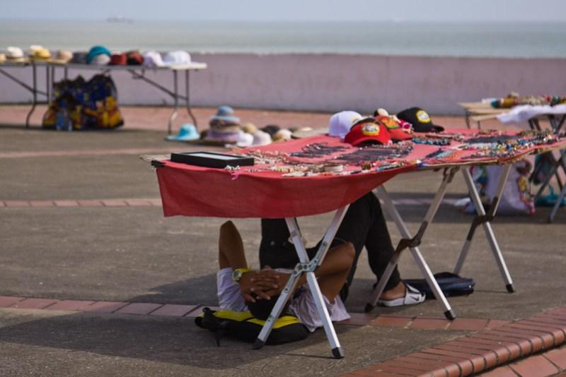Kuna vendor hiding from the sun in Casco Viejo Panama, while taking the siesta.