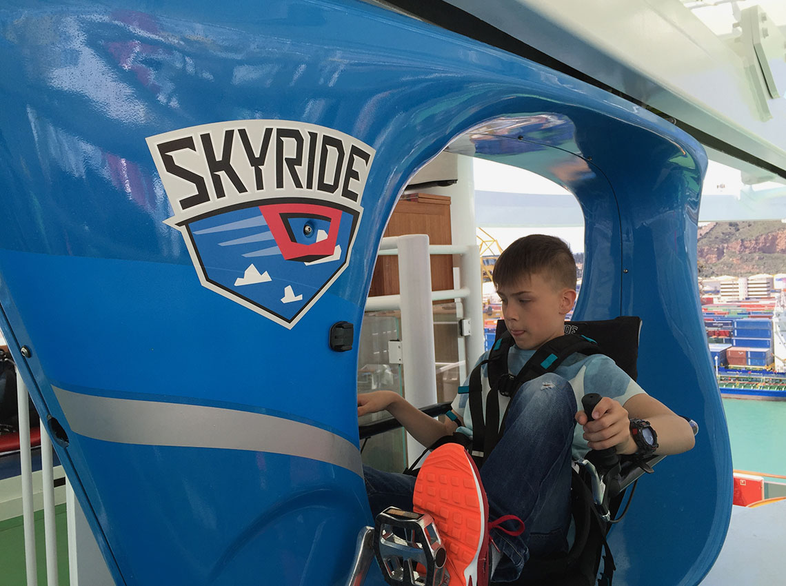 Ben Kolbel, 10, gets ready for his trip on SkyRide. Photo Credit: Tom Stieghorst