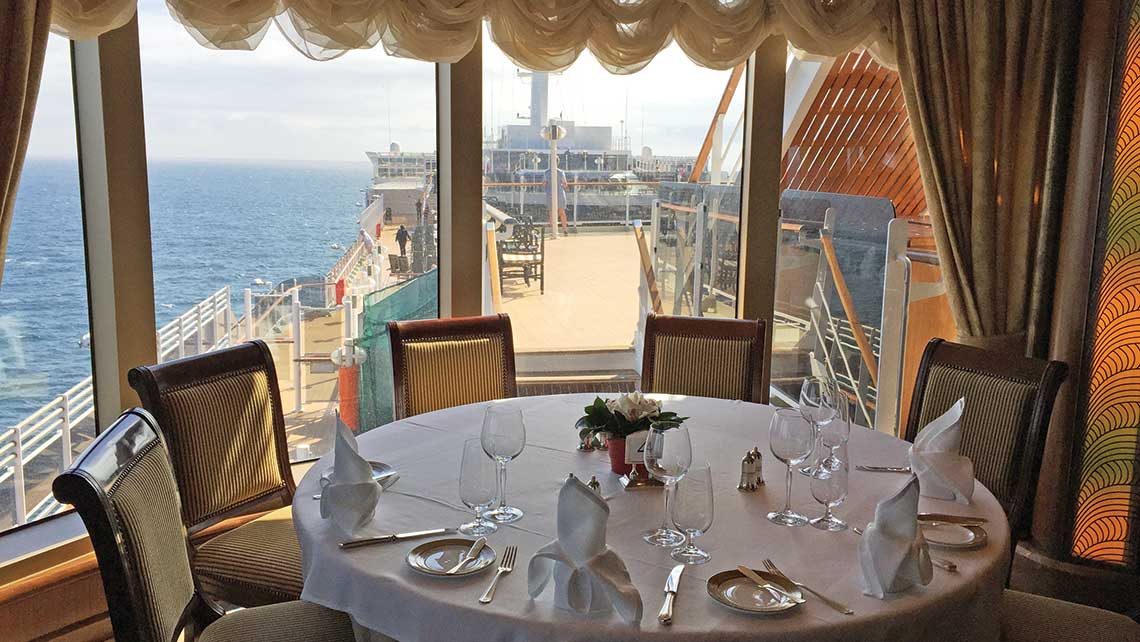 A table in the Queens Grill on Cunard Line's Queen Victoria, which offers a sweeping view. Photo Credit: TW photo by Tom Stieghorst