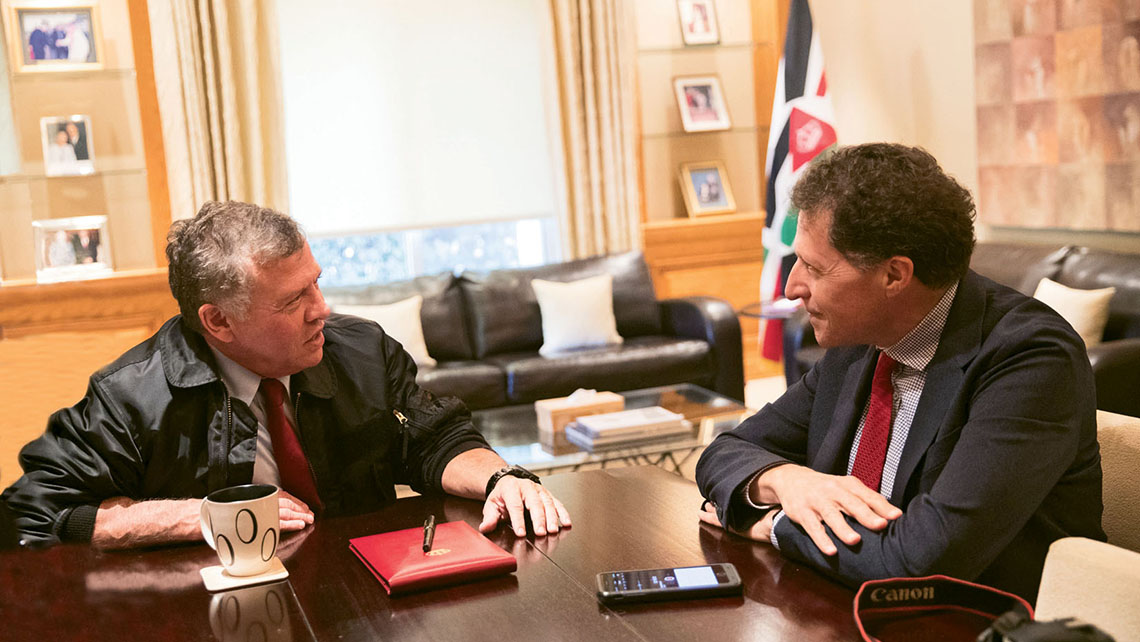 King Abdullah II of Jordan, left, and Travel Weekly's Arnie Weissmann talk travel at the royal palace. Photo Credit: Courtesy Royal Hashemite Court
