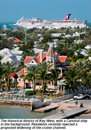 The historical district of Key West, with a Carnival ship in the background.
