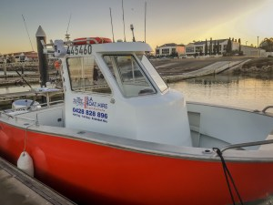 B.A. Boat Hire Amara Centre Cab vessel in the water at North Haven Marina, Adelaide - Boat Hire Adelaide
