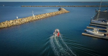 Drone photo of boat rental leaving North Haven Marina