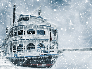 Winter old cruise boat paddle boat in snow