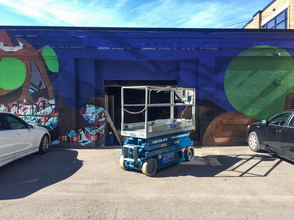 Bruno Smoky Painting Halls Lane Mural in Downtown Kitchener