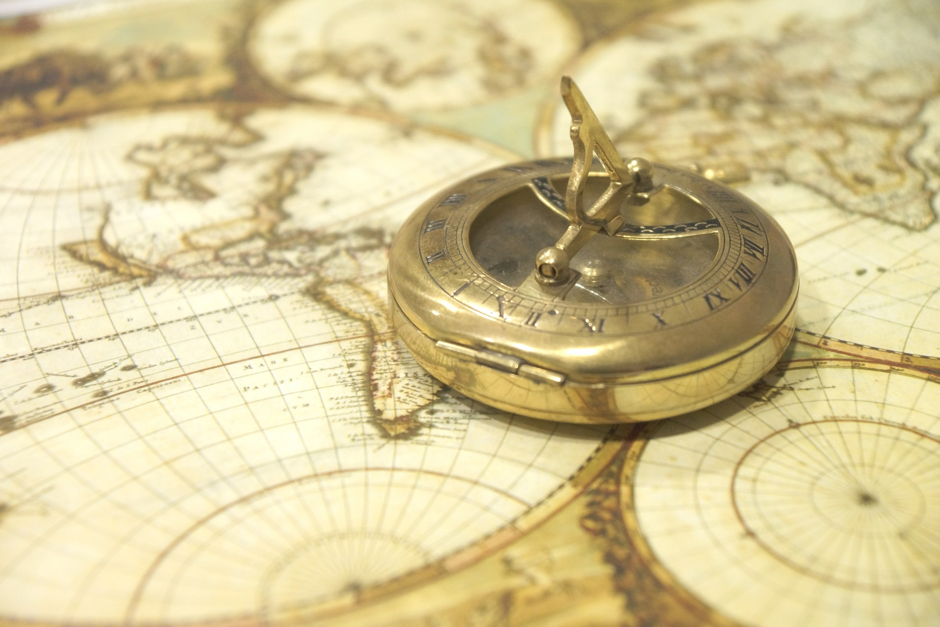 A compass resting on a map - how to plan your itinerary for Southeast Asia