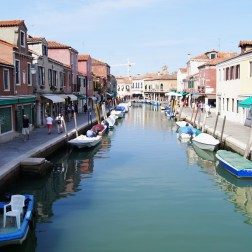 The islands of Murano and Burano are islets near Venice. They are part of the municipality that governs Venice but maintains a unique, less crowded culture. Murano is known for its production of glass.