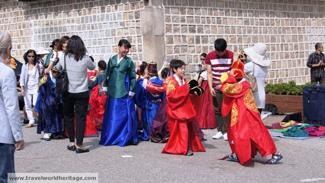 Children prepare for a reenactment of life in the palace.