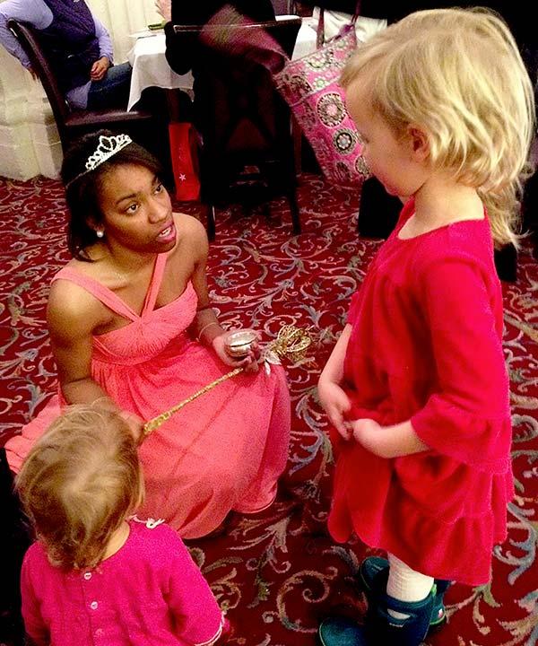 girls meet Christmas fairy at Macy's Walnut Room