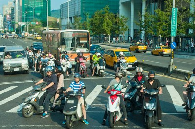 Mopeds crowd intersections, Busan