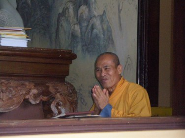 Buddhist monk offering a greeting
