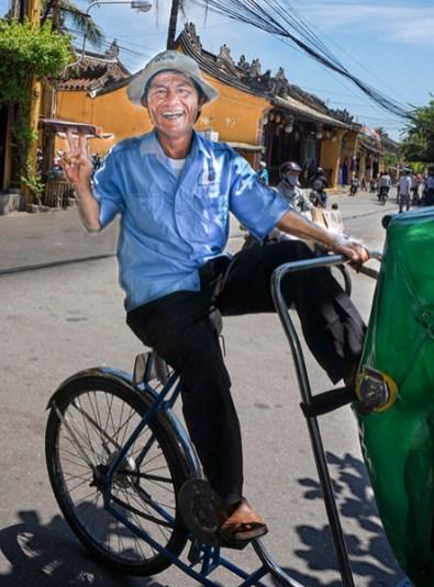 Cyclo (bicycle taxi) driver, Hoi An