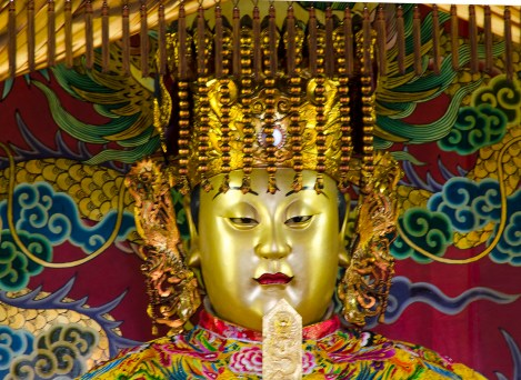 the deities may be styled as an emperor might be, complete with beaded headdress, or more as a traditional jolly Buddha, here at the Chung Tai Chan monastery in central Taiwan.