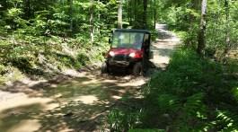 UTV in a muddy spot on the trail. Photo Credit: Linda Askomitis