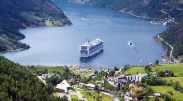 Geirangerfjord-Our cruise ship anchored off the town of Geiranger. Photo Credit: Jennifer Crites
