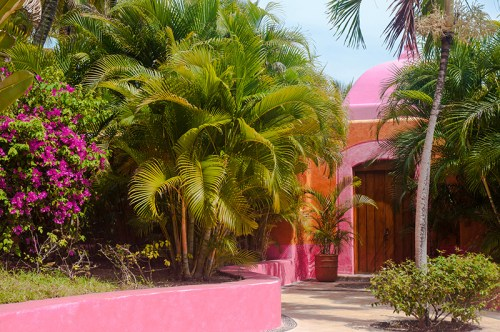 Las Alamandas entrance to the pink ocean front villa Casa del Sol