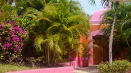 Las Alamandas entrance to the pink ocean front villa Casa del Sol