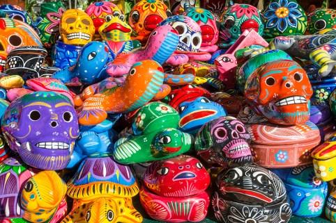 Colorful ceramic skull and animal figure souvenirs on sale at Velas Vallarta Hotel, Puerto Vallarta, Mexico.