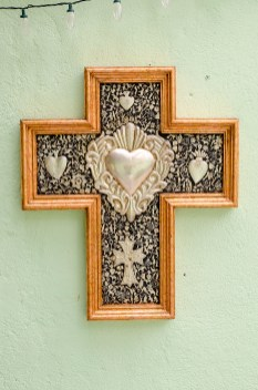 Traditional cross with metal sculpture