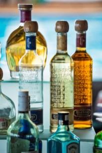 Tequila bottles at the bar in Mantanar Beach Club