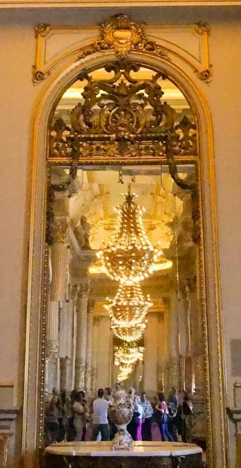 Chandelier festooned hallway at Teatro Colon