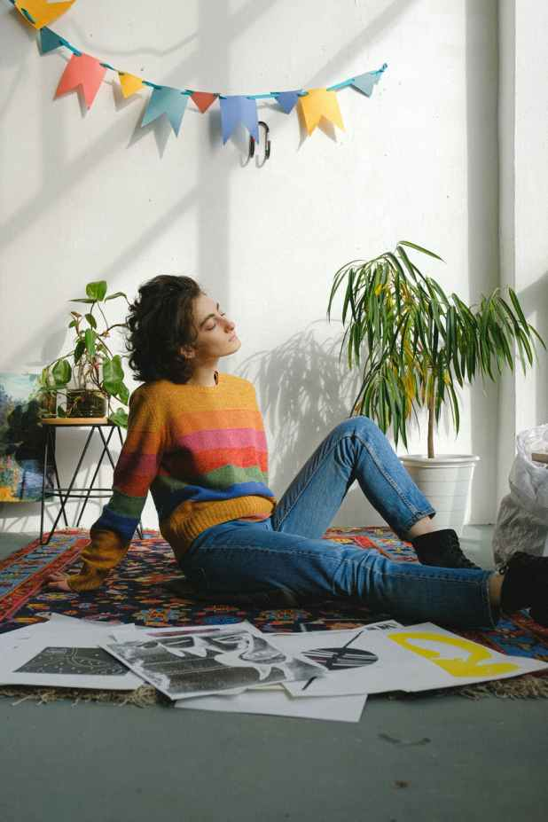 dreamy young artist having rest sitting on floor