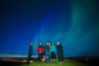Striking a pose under the Northern Lights in Iceland