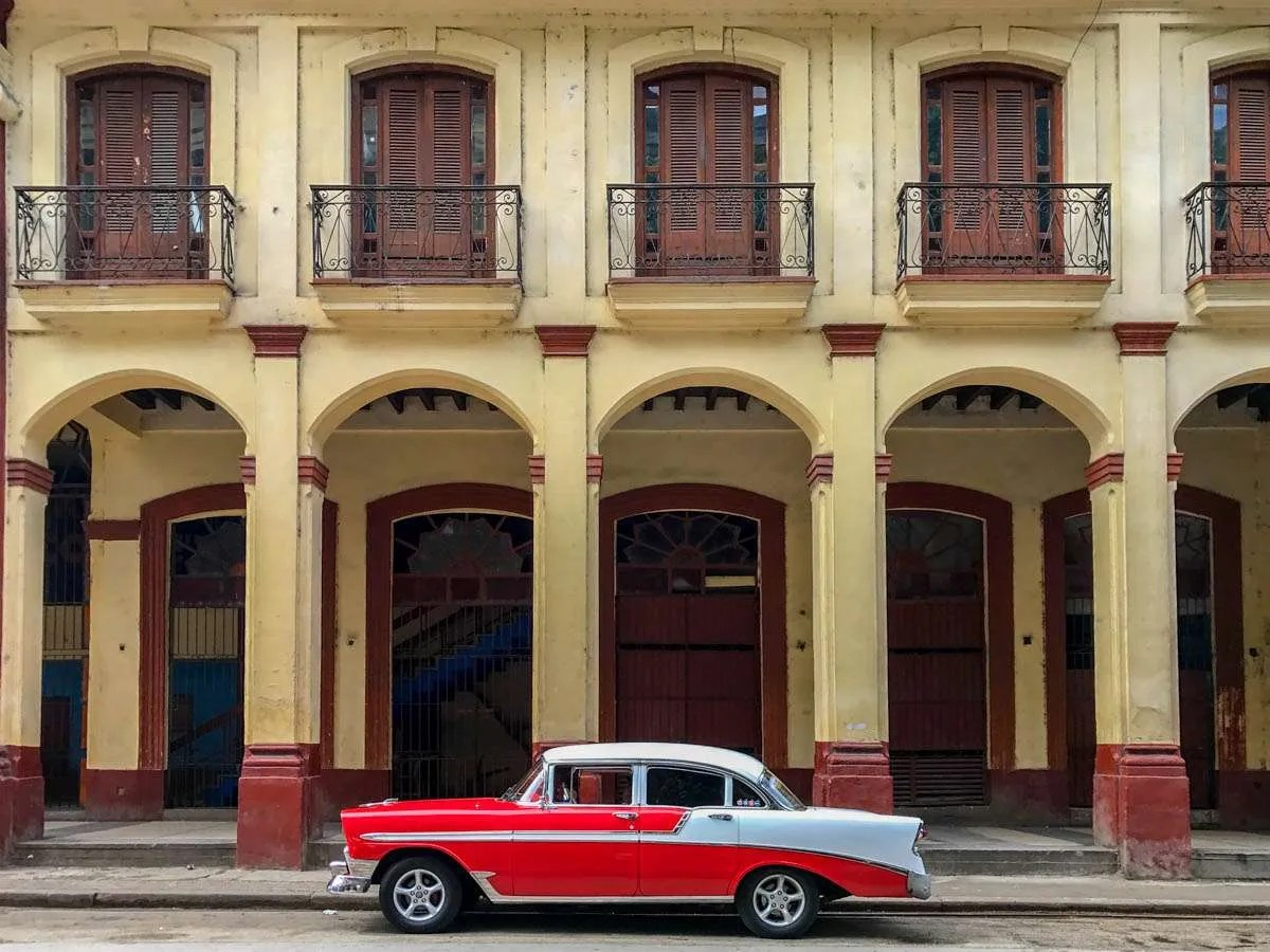 Classic car in front of colonial building in Havana