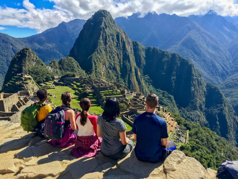 Sitting in front of Machu Picchu Peru