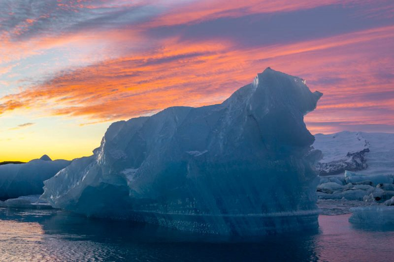 Iceberg under the winter sunset