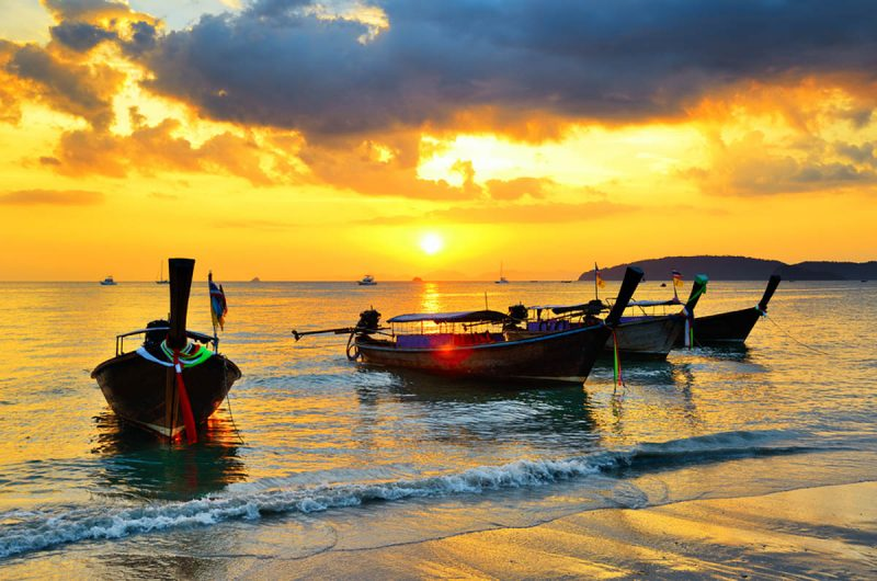 Long boats in the sunset on Krabi Thailand