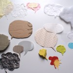 Speech bubbles made of different kinds of paper