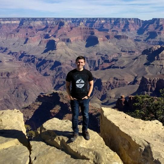 Álvaro Lozano-Robledo standing on a rock at the Grand Canyon