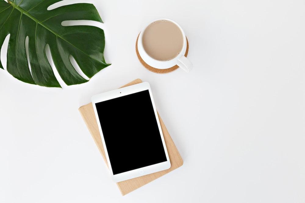 iPad coffee and leaf on desk