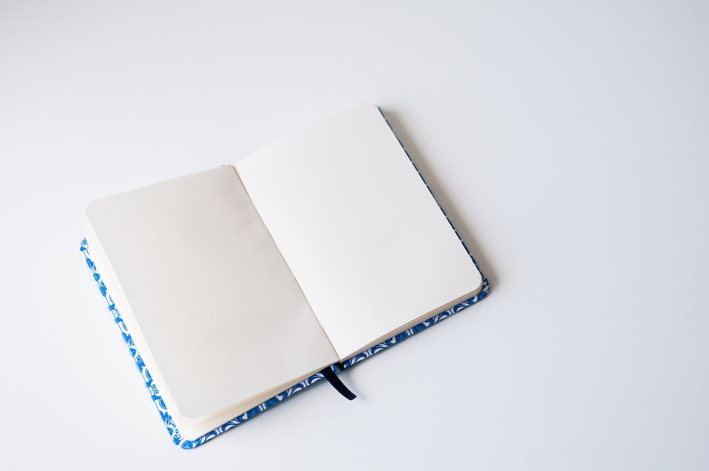 blank notebook on white desk