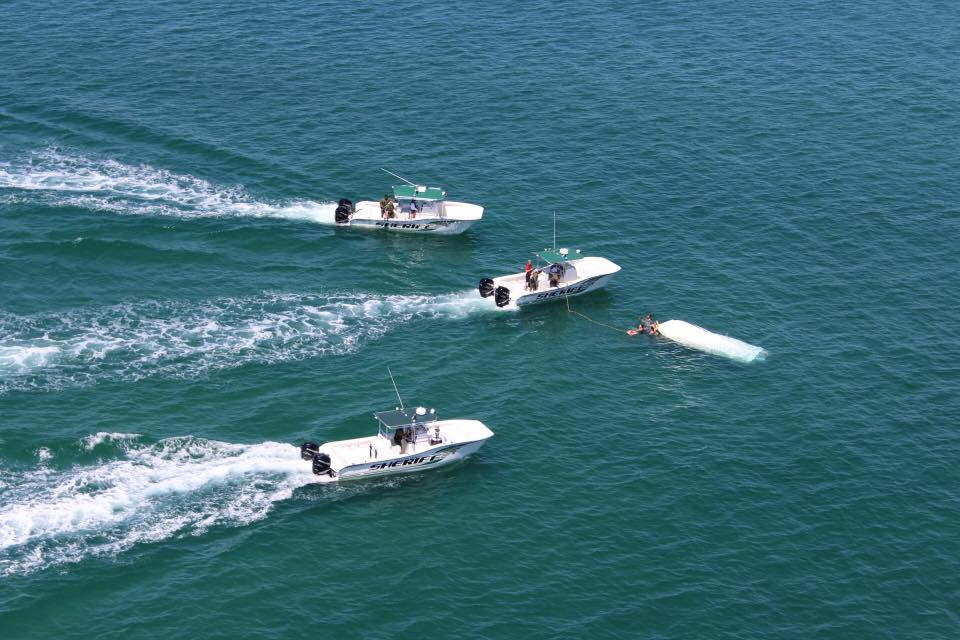 St Lucie Sheriff rescues four adults after boat overturns