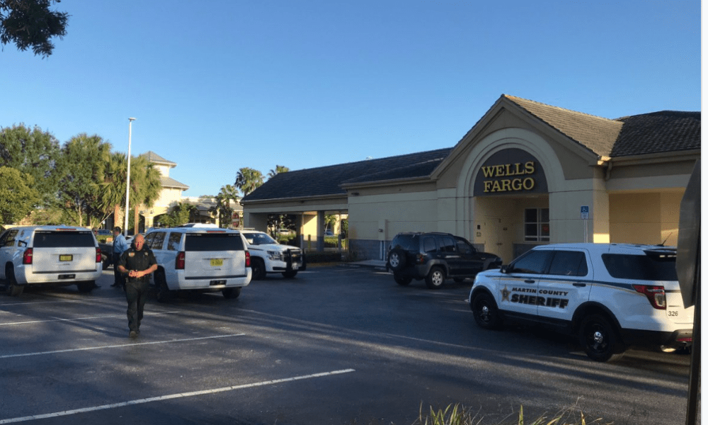Armed bank robbery in Palm City. Robber at large.
