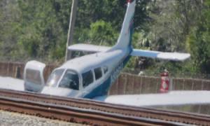 Small Plane lands on railroad tracks in Vero Beach