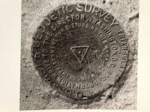 Geodetic marker at Mt Pisgah. This ancient sandbar rises 57 feet above today's sea level. IT is the highest point in Sewall's Point. (Photo Sandra H. Thurlow.)