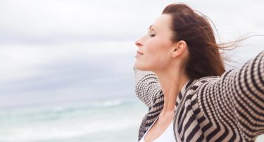 woman-practicing-healthy-breathing-outside