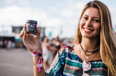 woman-with-cbd-isolate-jar