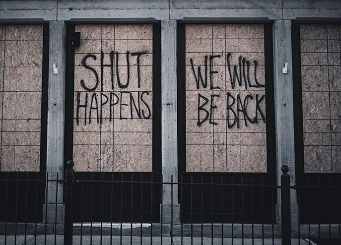 boarded up shop window due to lockdown
