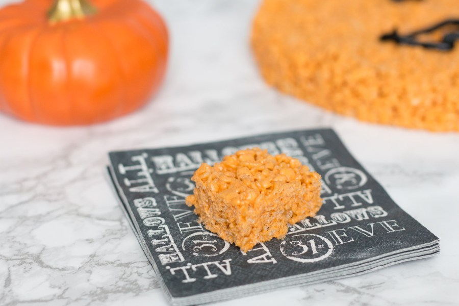 this giant pumpkin rice krispies treat would be really fun to serve at a halloween party i suggest leaving it whole and then have a knife nearby for guests