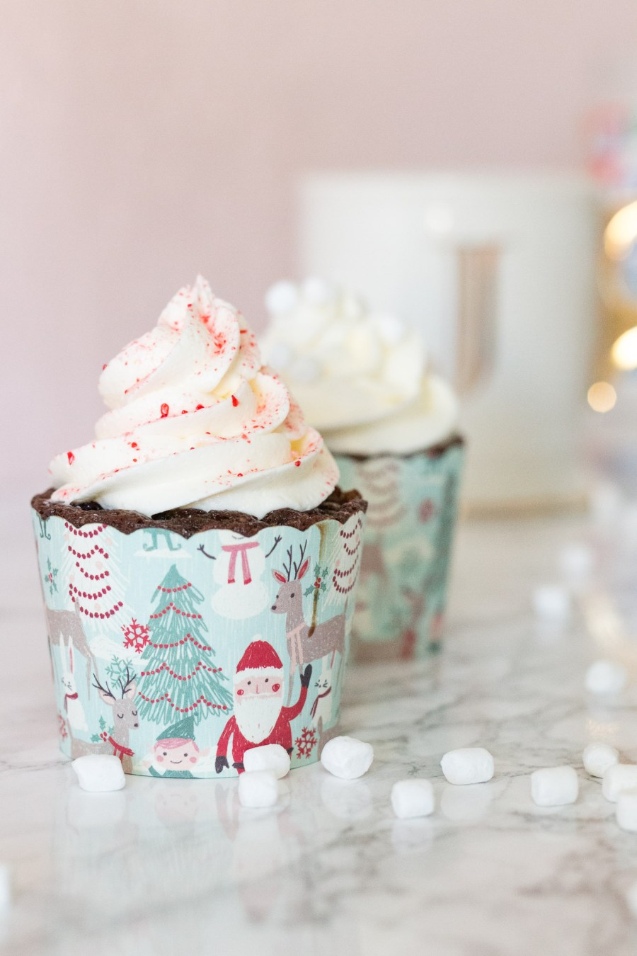 peppermint hot chocolate cupcakes with marshmallow buttercream and candy cane sprinkles for holiday party dessert