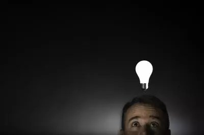 A picture of a man and a lightbulb by Michagan State University