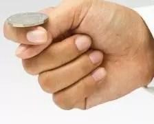 A picture of a cointoss by Freedigitalphotos.net/patpitchaya
