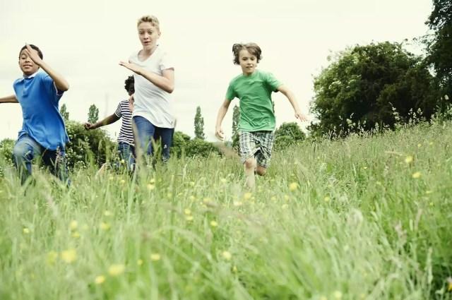 kids running through a field