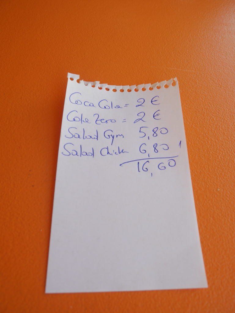 The bill for chicken and gyro salad at Filippas